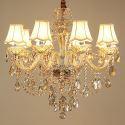 Attraktiver Kronleuchter Kristall Kerzen Design in Beige für Wohnzimmer